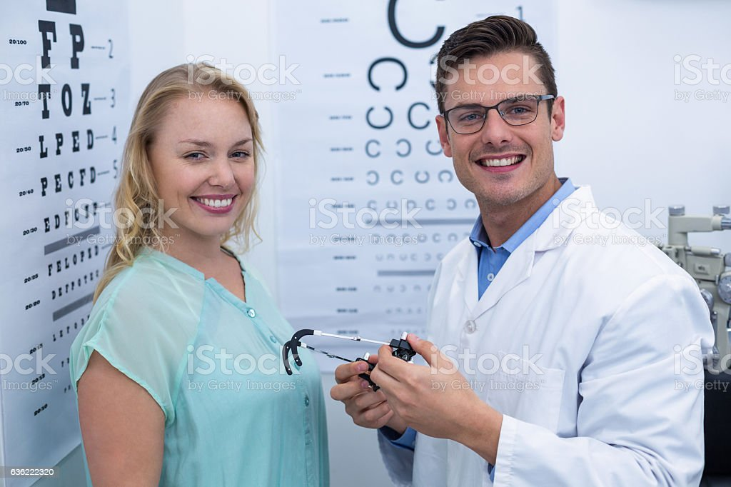 Portrait of female patient and optometrist stock photo