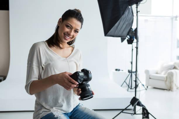 Portrait of female photographer holding digital camera picture id656503906?b=1&k=6&m=656503906&s=612x612&w=0&h=qdwi skxake9vkxmy02m8uibtg5hdzc5 og5modcyyc=