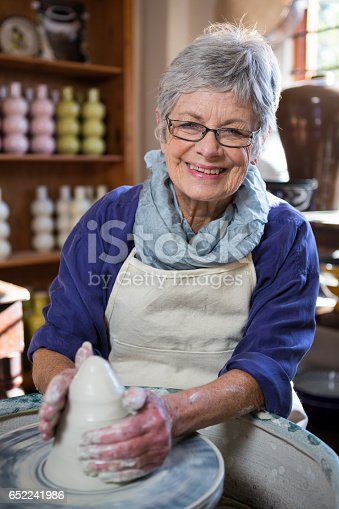 istock Portrait of female potter making pot 652241986