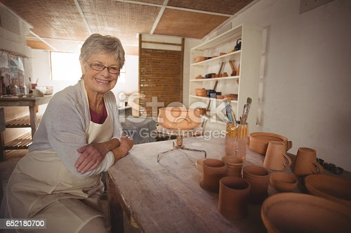 652188430 istock photo Portrait of female potter sitting at table 652180700