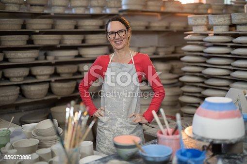 istock Portrait of female potter standing near worktop 856073886