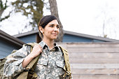 istock Portrait of female soldier carrying gear 1209896801