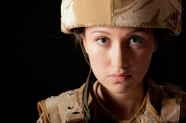 Portrait Of Female Soldier Portrait of a female soldier wearing British Military desert camouflage uniform. mount combatant stock pictures, royalty-free photos & images