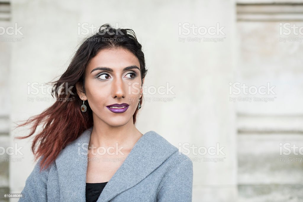 Portrait of female transgender with brown hair looking away stock photo
