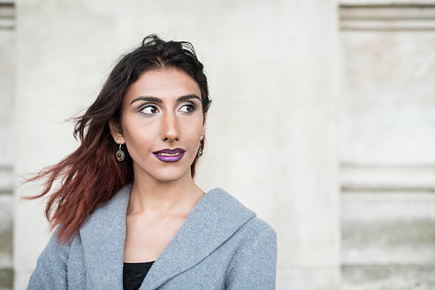 portrait of female transgender with brown hair looking away - transsexual stock photos and pictures