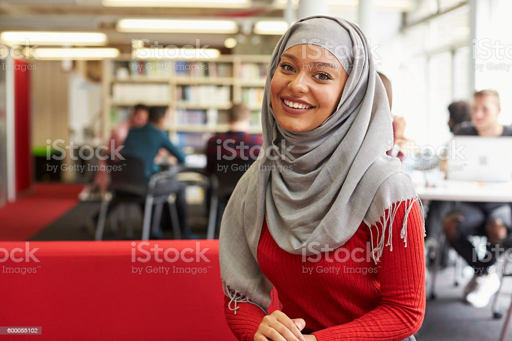 Portrait Of Female University Student Working In Library stock photo