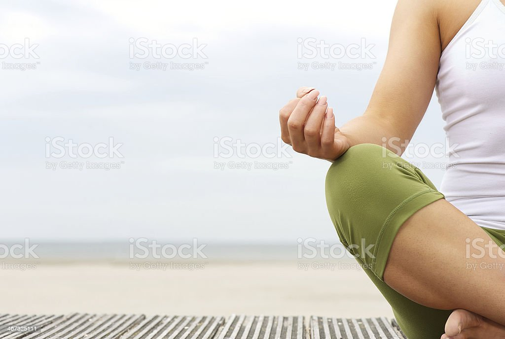 Portrait of female yoga hands at the beach stock photo