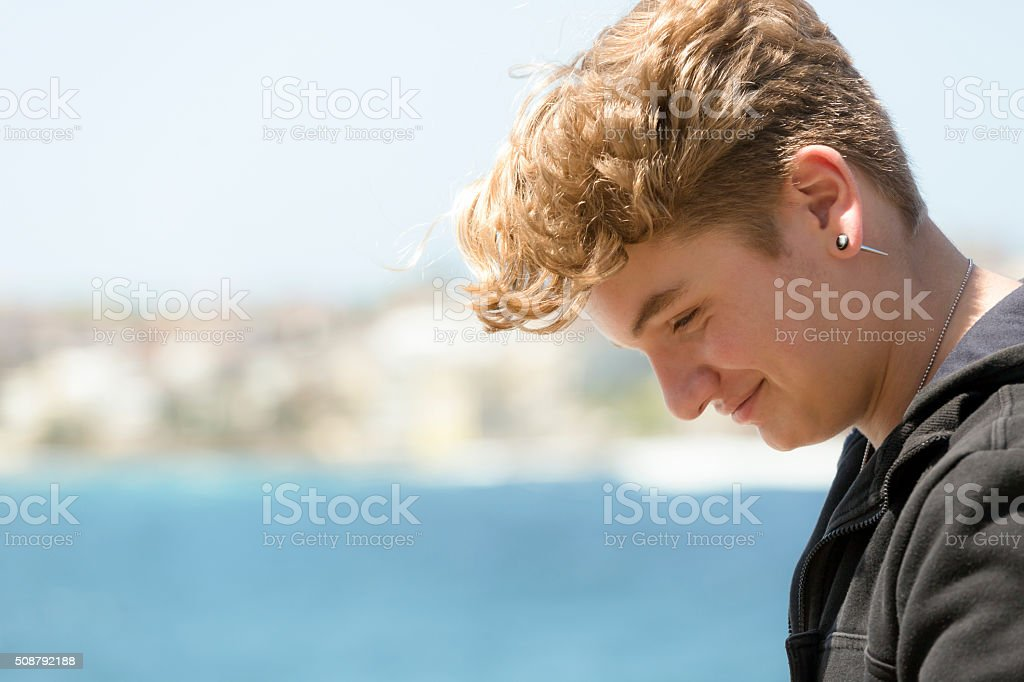 Portrait of fifteen years old teenage boy, profile, copy space​​​ foto