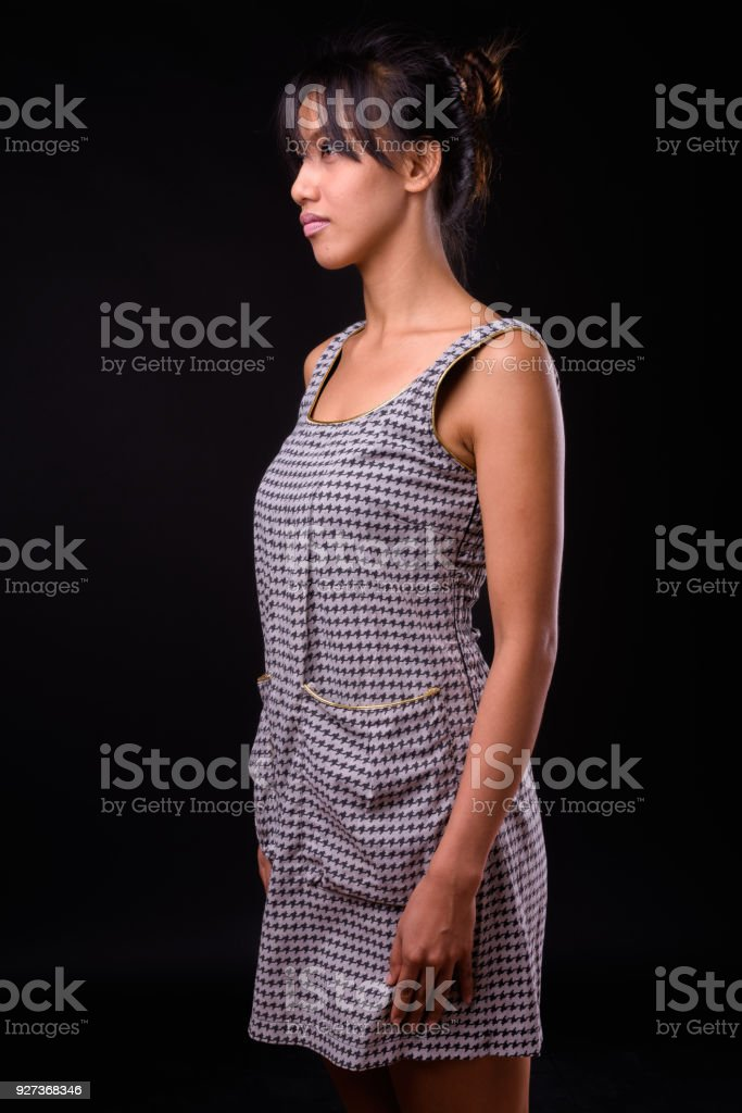 Portrait Of Filipino Woman Against Black Background - Royalty-free 25-29 Years Stock Photo