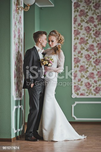 Portrait of beautiful pair in a room.