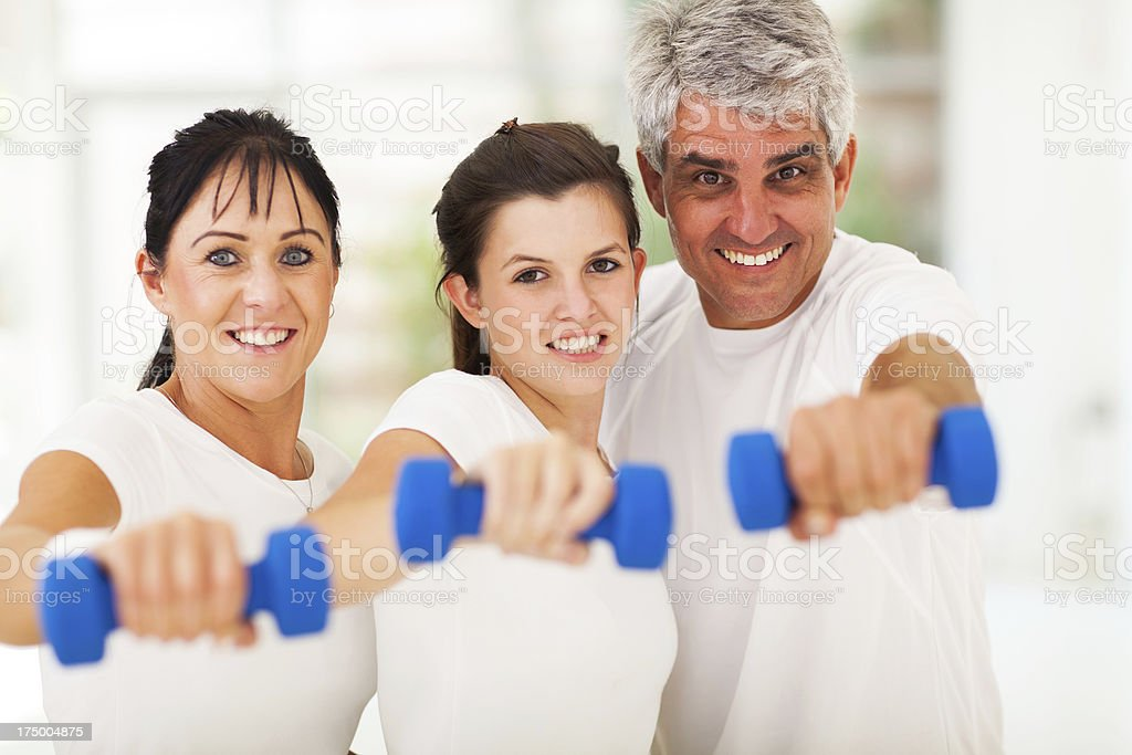 portrait of fit family having fun with dumbbells royalty-free stock photo