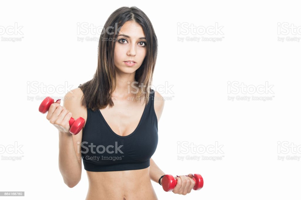 Portrait of fit girl exercising with two dumbbells royalty-free stock photo