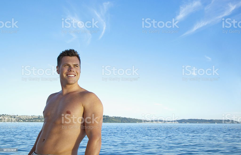 Portrait of fit man without shirt on, on sailboat royalty-free stock photo