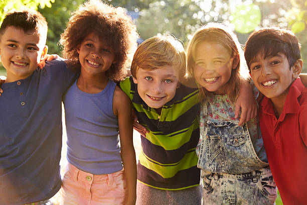 Portrait Of Five Children Having Fun Outdoors Together Portrait Of Five Children Having Fun Outdoors Together 8 9 years stock pictures, royalty-free photos & images