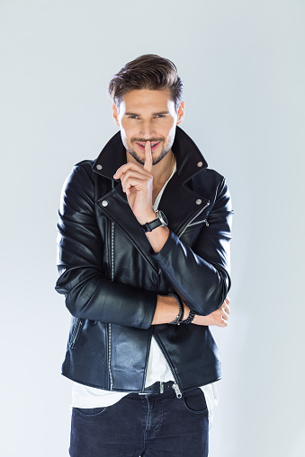 Portrait Of Flirting Handsome Man Wearing Leather Jacket Stock Photo - Download Image Now