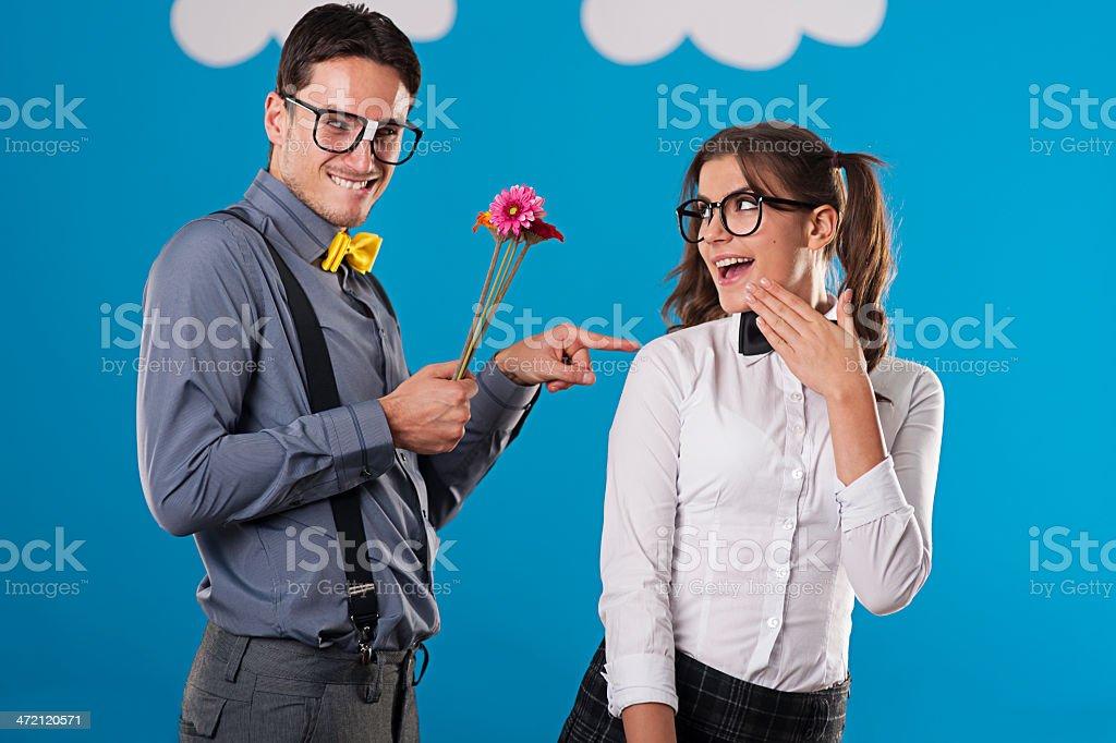 Portrait of flirting nerdy couple stock photo
