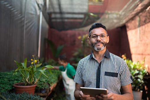 Portrait of Florist Using Tablet at Small Business Flower Shop