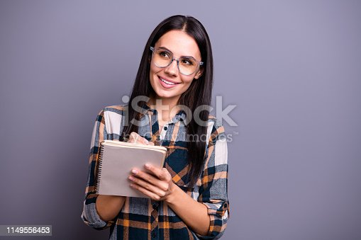 istock Portrait of focused concentrated teen teenager college take notes guess inspired imagine interested contemplate prepare report stylish checked shirt trendy isolated on grey background 1149556453