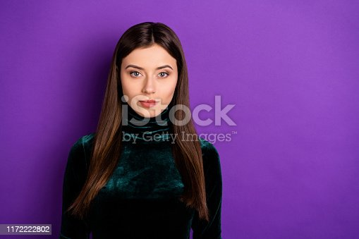 Portrait of focused pretty woman looking at camera wearing black turtleneck isolated over purple violet background