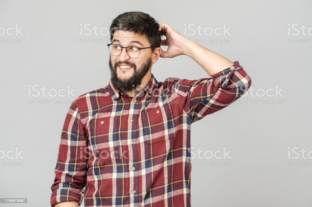 Portrait of focused smart male model with with thoughtful determined expression, thinking. Isolated over grey Portrait of focused smart male model with with thoughtful determined expression, thinking. Isolated over grey Adult Stock Photo