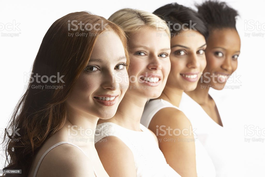 Portrait Of Four Attractive Young Women In Studio stock photo
