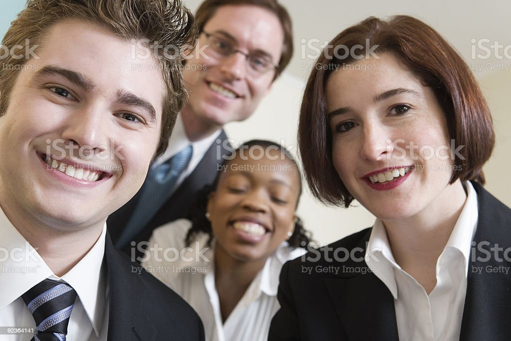 Portrait of four business people smiling. royalty-free stock photo