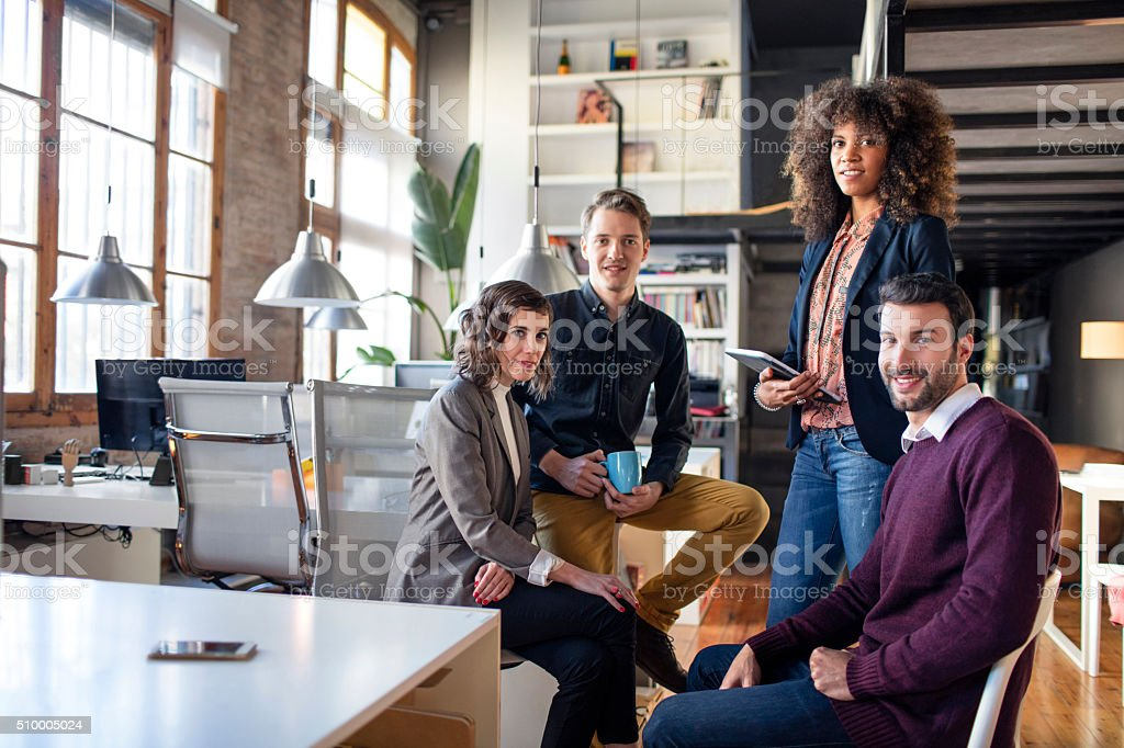 Portrait of four creative business people in the office stock photo