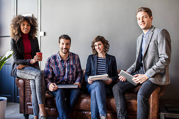 portrait of four creative business people - four people stock photos and pictures