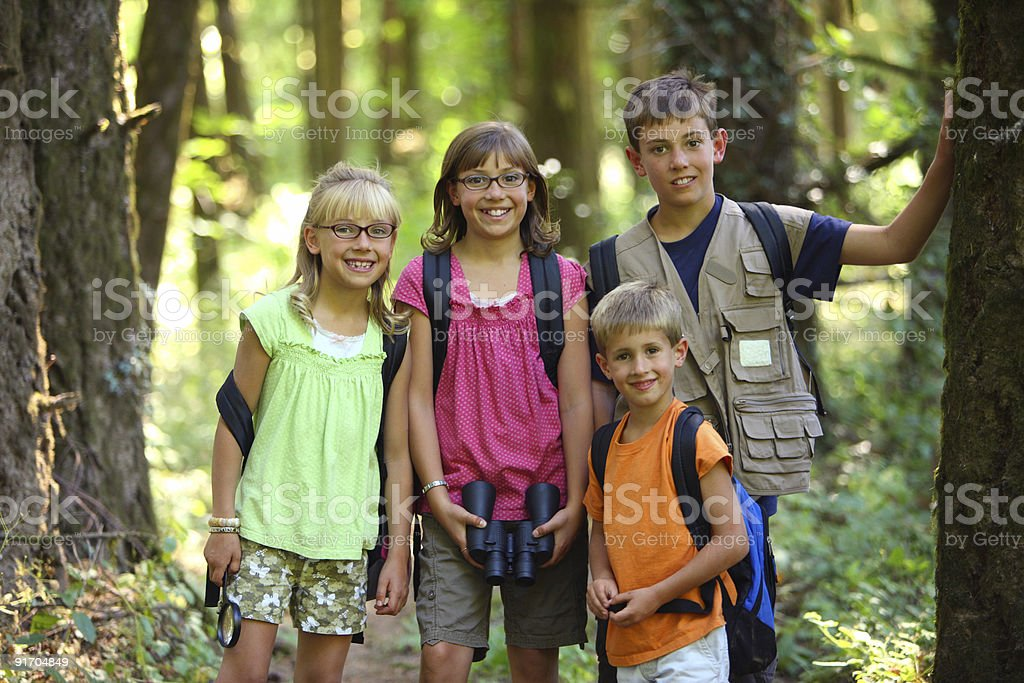 Portrait of four kids with camping gear stock photo
