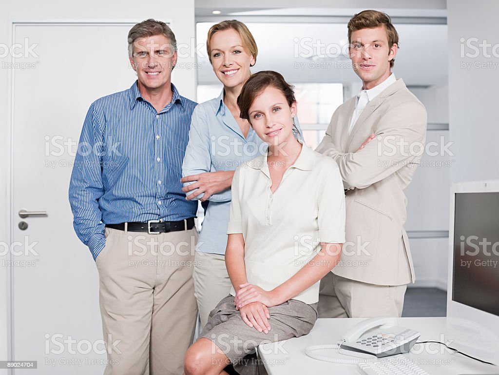 Portrait of four office workers royalty-free stock photo