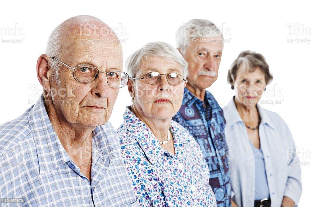 Portrait of four serious seniors stock photo