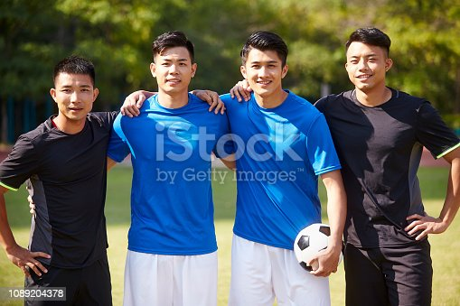 istock portrait of four soccer players 1089204378