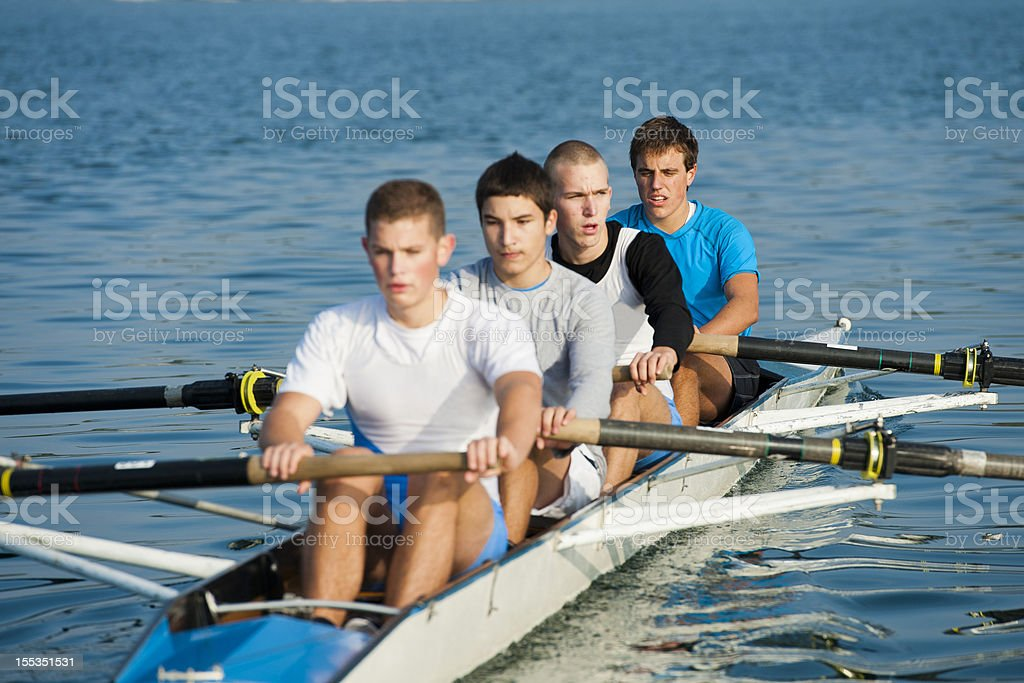 Portrait of four-seated scull rowing team stock photo