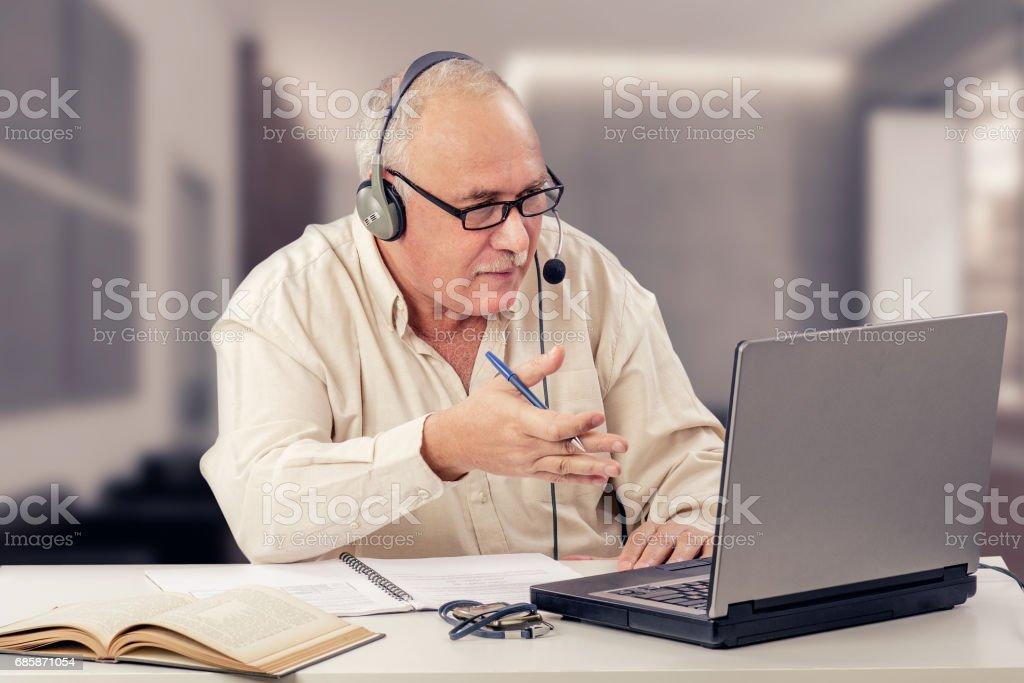 Portrait of freelance online teacher in headset stock photo