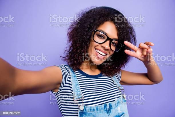 Portrait of friendly positive blogger in headwear eyewear shooting picture id1009507882?b=1&k=6&m=1009507882&s=612x612&h=4mroho kk2sptg86svcdypksh3 eh48tl4cz0bhii6g=