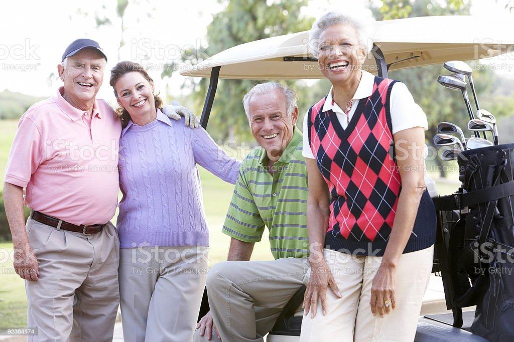 Portrait Of Friends Enjoying Golf royalty-free stock photo
