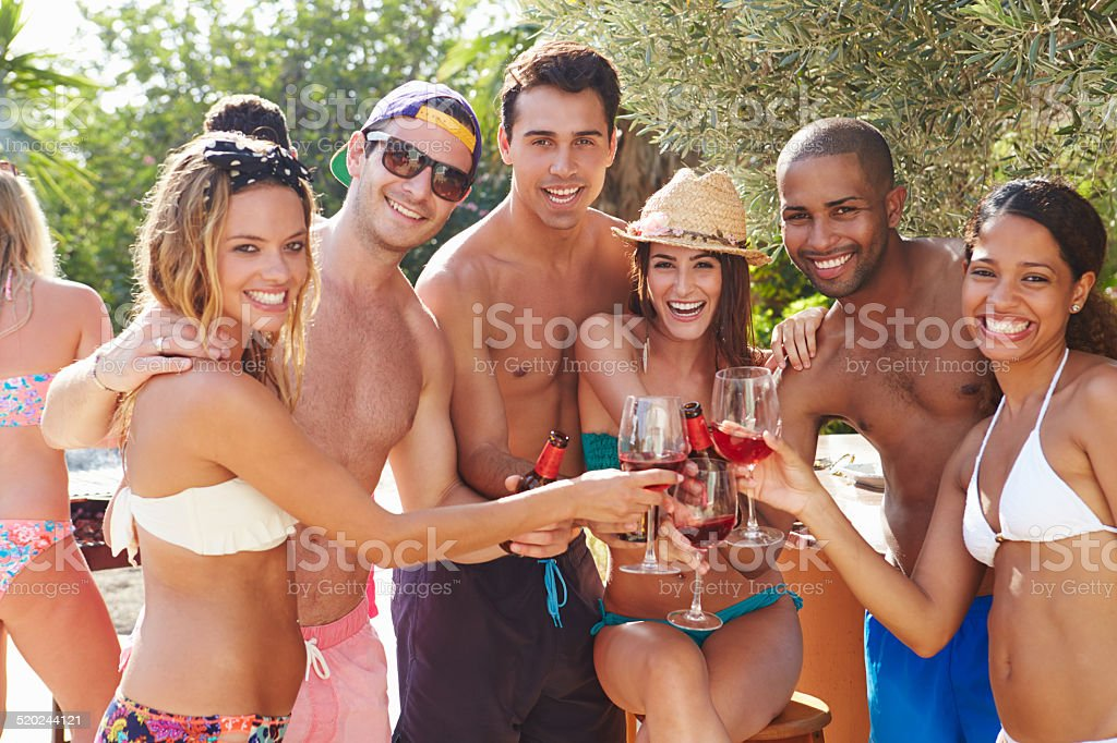 Portrait Of Friends Having Party By Swimming Pool stock photo