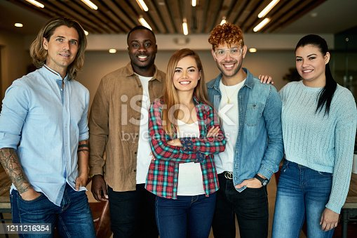 502281620 istock photo Portrait of Friends in Coworking Office Environment 1211216354