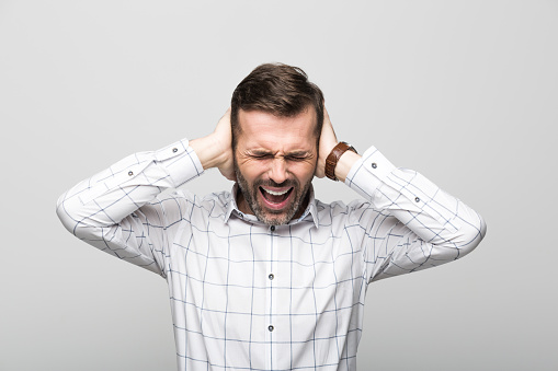 Portrait Of Frustrated Businessman Grey Background Stock Photo - Download Image Now
