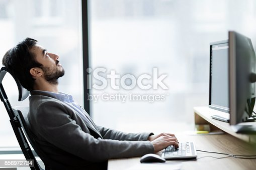 istock Portrait of frustrated businessman having problems in his work 856972734