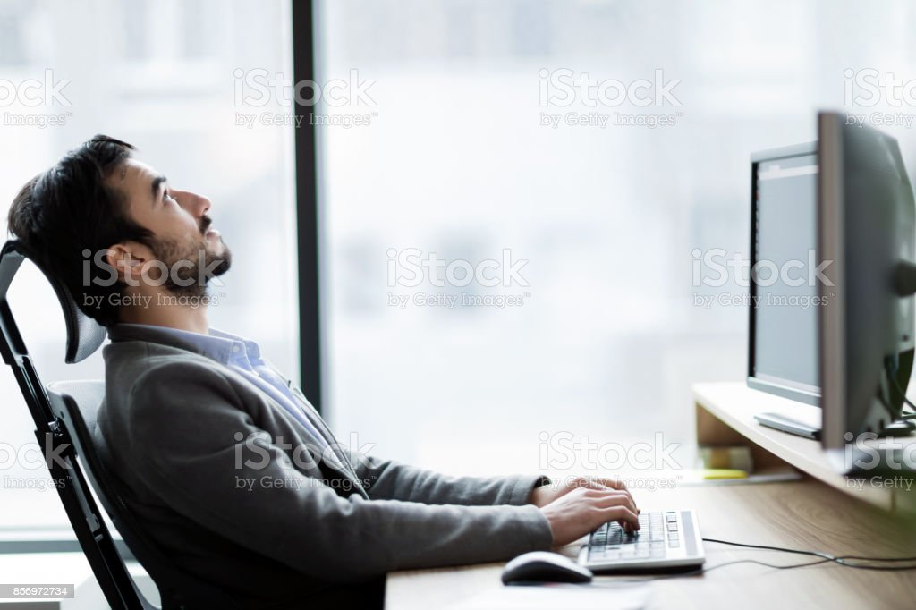 Portrait of frustrated businessman having problems in his work stock photo