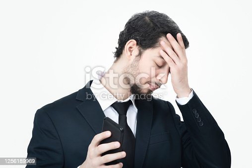 626916886 istock photo Portrait of frustrated young businessman on white background 1256189969