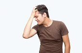 istock Portrait of frustrated young man over white background 531047628