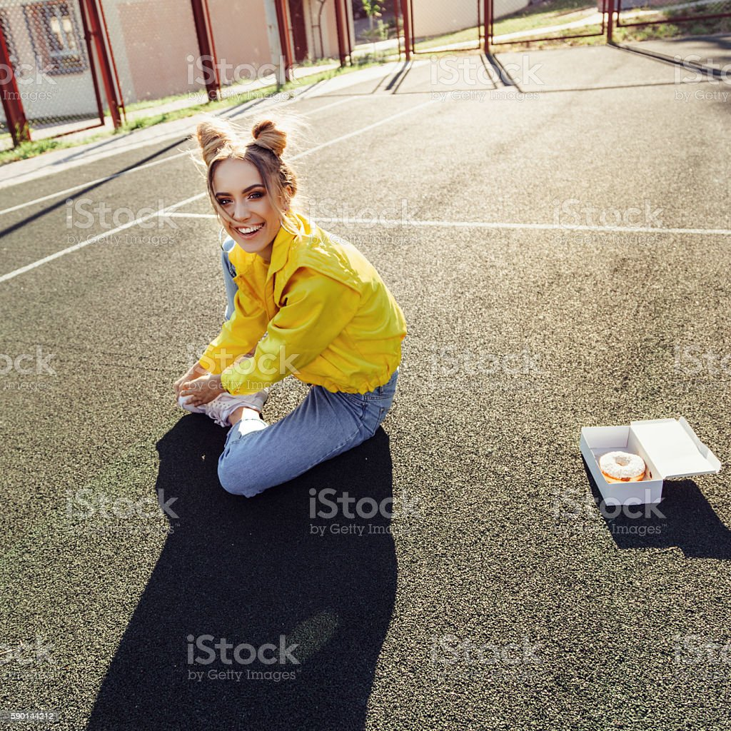 Portrait of funny beautiful girl with donut stock photo