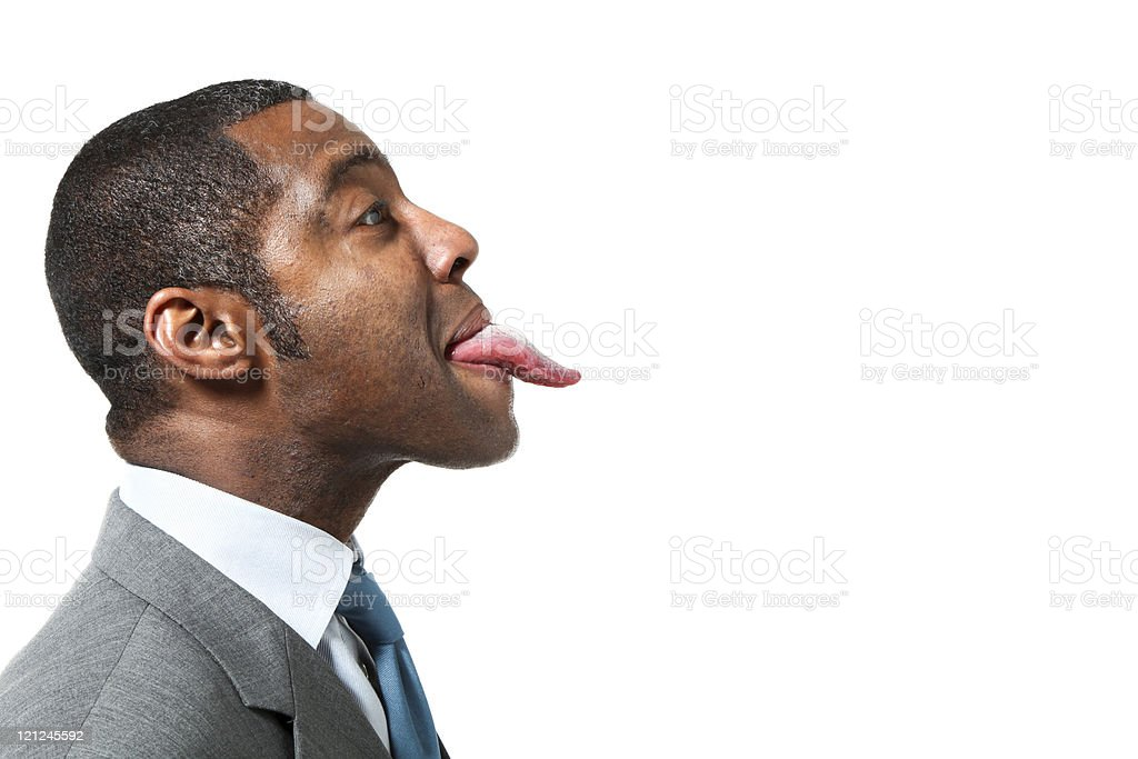 portrait of funny black man with suit over white background stock photo