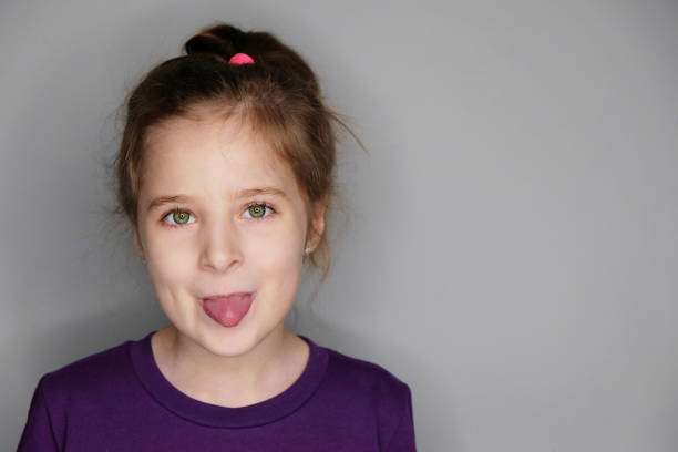 Portrait of funny little girl stock photo