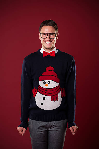 portrait of funny man wearing sweater with snowman - ugly sweater stock photos and pictures