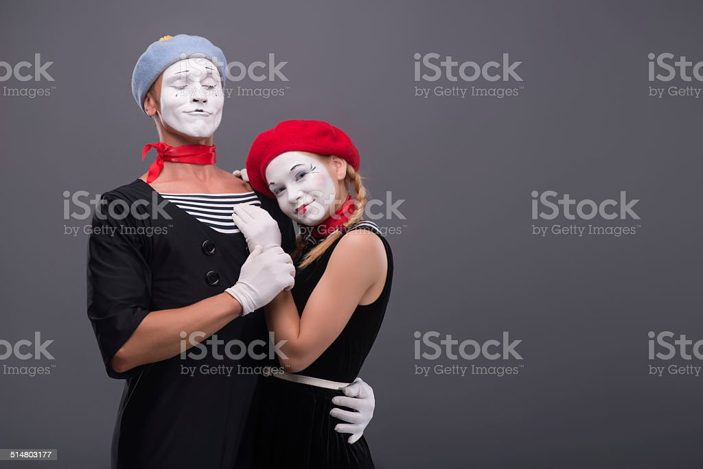 Waist-up portrait of mime couple hugging with love each other...