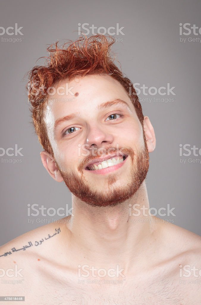 Portrait of funny red hair guy smiling. stock photo