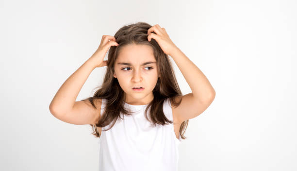 Portrait of furious little girl screaming. Angry little girl holding her hair with negative facial expression. sideways looking stock photo